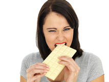 Young Woman Eating a White Chocolate Bar Stock Images