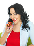 Young Woman Eating Wholegrain Cracker with Chocolate Spread and Fresh Sliced Strawberries Stock Photography