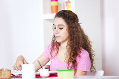 Young woman eating yogurt Royalty Free Stock Image