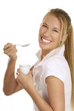 Young woman eating yogurt. On white background Royalty Free Stock Image