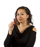 Young Woman Eats Chocolate. Young Woman Eats a piece of Chocolate Royalty Free Stock Images