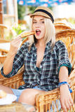 Young woman eats croissant Stock Photo