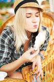 Young woman eats croissant Royalty Free Stock Image