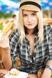Young woman eats croissant Stock Photos