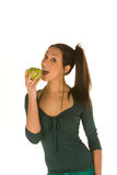 Young woman eats a granny smith apple Stock Photography