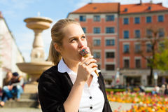 Young woman eats Ice cream Royalty Free Stock Photography