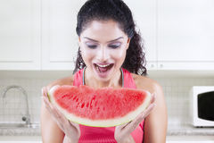 Young woman eats piece of watermelon Stock Photos