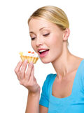 Young woman eats the sweet cake Stock Image