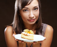 Young woman eats a sweet cake Royalty Free Stock Images