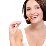 Young woman eats vegetable Royalty Free Stock Image