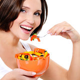 Young woman eats vegetable Royalty Free Stock Images