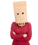 Young woman in ecological paper bag on head Stock Photo