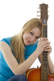 Young woman with electric guitar Royalty Free Stock Photos