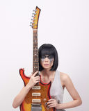 Young woman with electric guitar Stock Photos
