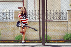 Young woman with electric guitar - outdoors fashion portrait Royalty Free Stock Photography