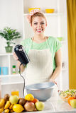 Young woman with electric mixer Stock Photos