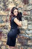 Young woman in elegant black dress and gloves Royalty Free Stock Photos