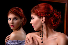 Young woman with elegant braided hairstyle and professional makeup Stock Image