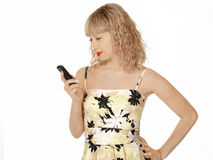 The young woman in elegant clothes looks at a mobile Stock Photo