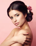 Young woman with elegant hairstyle and flowers accessory Royalty Free Stock Images