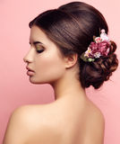 Young woman with elegant hairstyle and flowers accessory Stock Photo