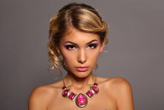 Young woman with elegant hairstyle and luxurious necklace Stock Images