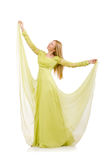 The young woman in elegant long green dress isolated on white Stock Photography