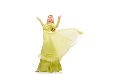 The young woman in elegant long green dress isolated on white Stock Images
