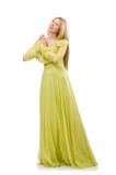 The young woman in elegant long green dress  on white Royalty Free Stock Image