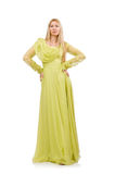 The young woman in elegant long green dress  on white Royalty Free Stock Photography