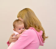 The young woman embraces the baby Royalty Free Stock Images