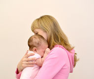 The young woman embraces the crying baby Royalty Free Stock Photography
