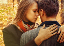 Young woman embraces a man, couple in love royalty free stock photography