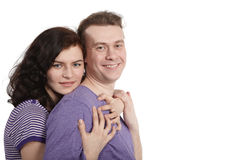 Young woman embraces a young man from behind. Royalty Free Stock Photography