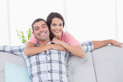 Young woman embracing happy man Royalty Free Stock Photo