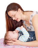 Young woman is embracing her baby. Young mother with her baby on white background Royalty Free Stock Image