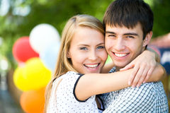 Young woman embracing her boyfrend Royalty Free Stock Images