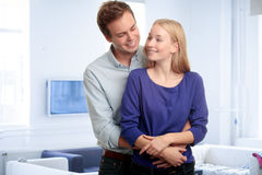 Young woman embracing her boyfriend Royalty Free Stock Photo