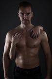 Young woman embracing a muscular man Stock Photography