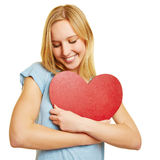 Young woman embracing red heart for love Stock Photos