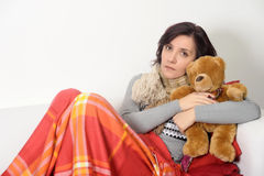 Young woman embracing teddy bear Royalty Free Stock Photography