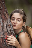 Young woman embracing a tree Stock Photos