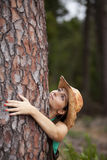 Young woman embracing a tree Stock Photography