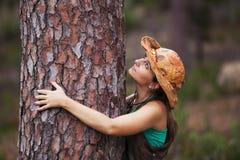 Young woman embracing a tree Stock Photos