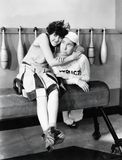 Young woman embracing a young man on a pommel horse Royalty Free Stock Photos