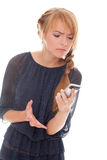 Young woman emotional talking on cell phone Stock Images