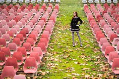 Young woman in empty auditorium Stock Photo