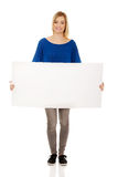 Young woman with empty banner. Royalty Free Stock Photos