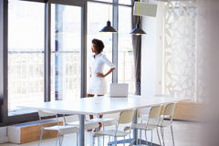Young woman in empty meeting room Royalty Free Stock Photography