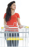 Young woman with empty shopping cart Stock Photography